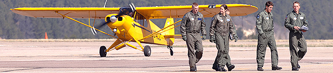 Image of cadets on the runway with Piper Super Cub in the background